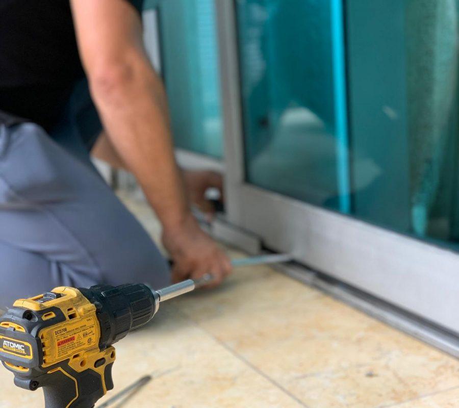 Sliding Glass Door Repair man executing service